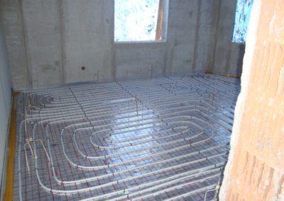 Ogrzewanie podłogowe i ścienne - dom jednorodzinny Kobyłka